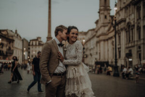 Newlywed couple in Piazza Navona, Rome at sunset